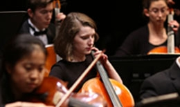 Student playing cello in the Dartmouth Symphony Orchestra