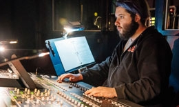 Dartmouth student at the soundboard during a theater performance